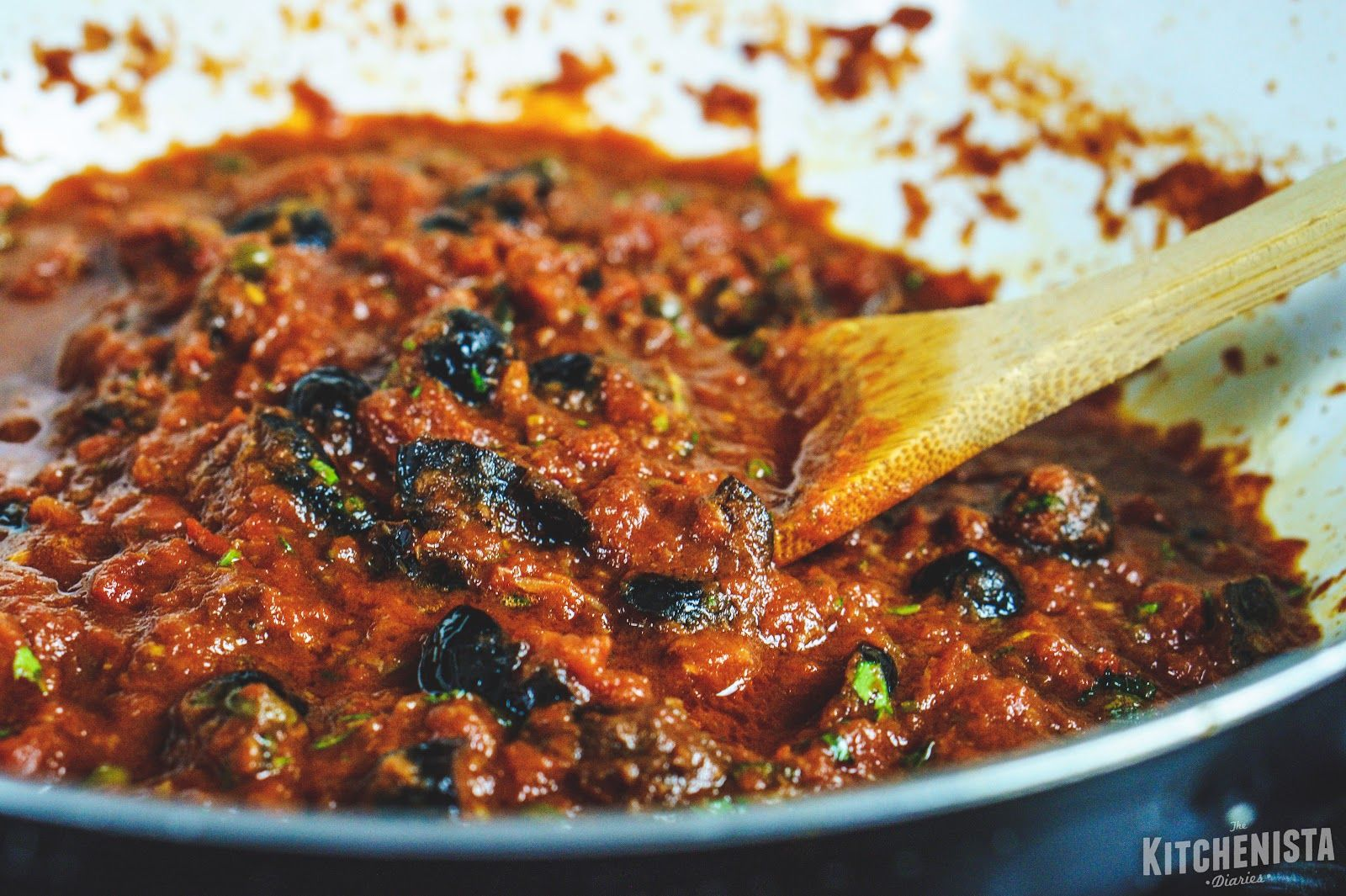 Puttanesca sauce is a robust, spicy tomato sauce flavored with an abundance of garlic, anchovies, olives and capers. Use it for pasta, fish or other proteins. Whole 30 and paleo compliant.