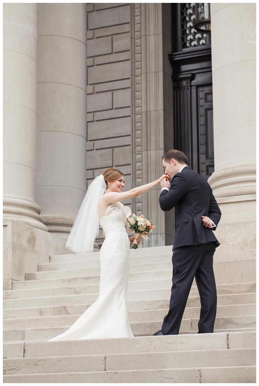 Beautiful bride and groom at the Carnegie Institution for Science in Washington, D.C. Bride's dress by J. Mendel and bouquet by Petals & Hedges. Image by Birds of a Feather.