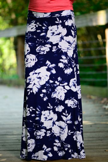 Amp up you maxi skirt game with this floral beauty! The fit and comfort is absolutely amazing! We are crazy about this bold maxi! The rich navy with the white roses make this a must have!