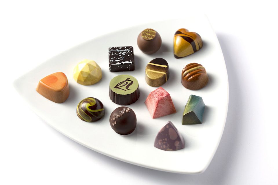 Norman Love Confections adds 11 new flavors to their mega-popular 'Signature Collection'. They taste even better than they look, if you can believe that.