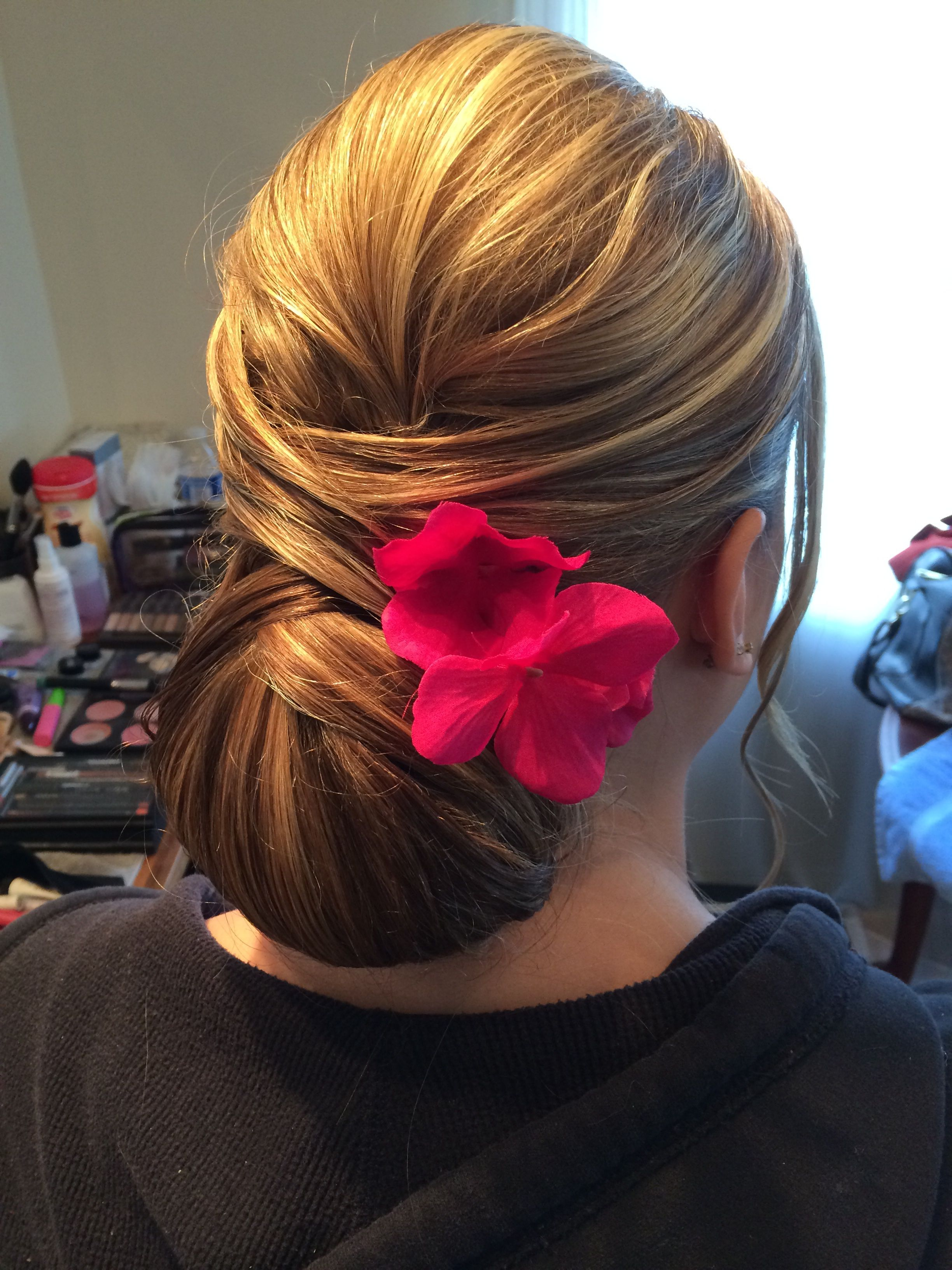Sleek updo by Kimberly Valosen