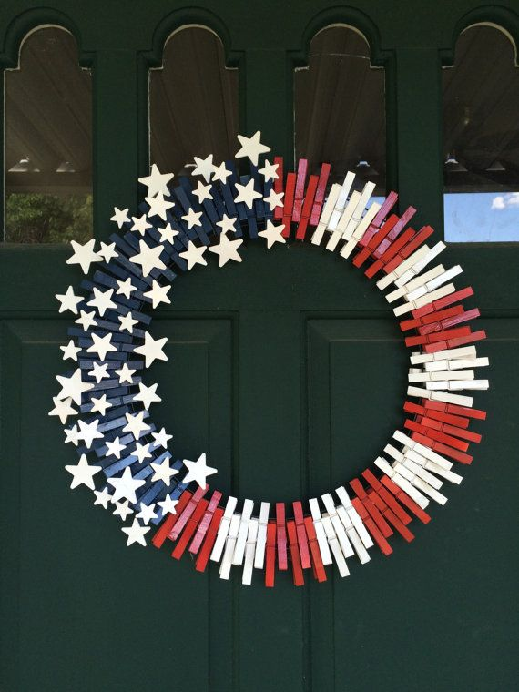 24 inch wreath frame with Red, White and Blue clothespins with 50 wooden white stars. Perfect July wreath or anytime wreath.