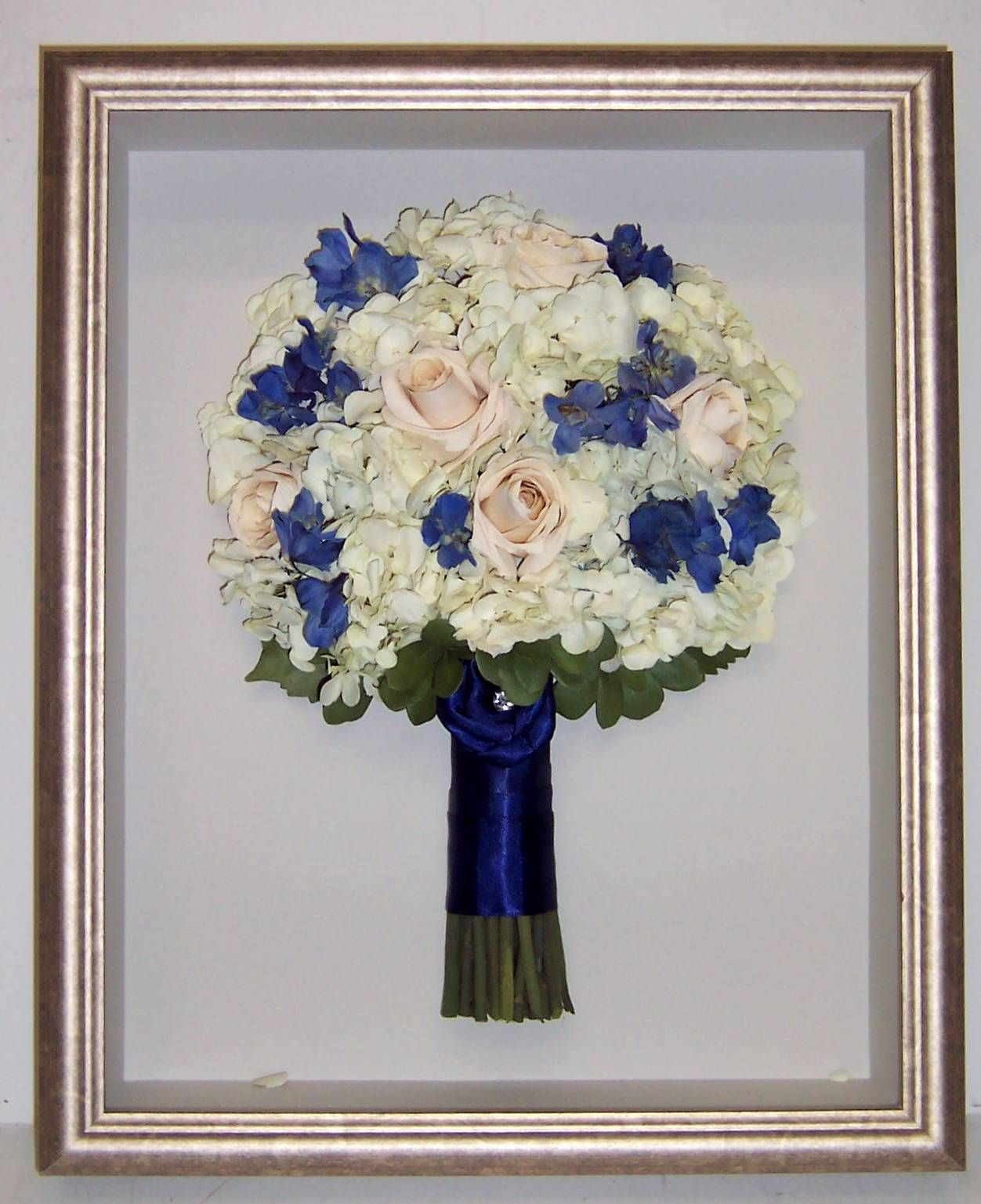 Colleen Dougherty had her bouquet framed using her original blue ribbon that brings out the blue in her lovely flowers. www.jenniferannedesigns.com