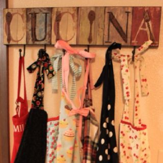 Fun way to display aprons...but i would put CUISINE.