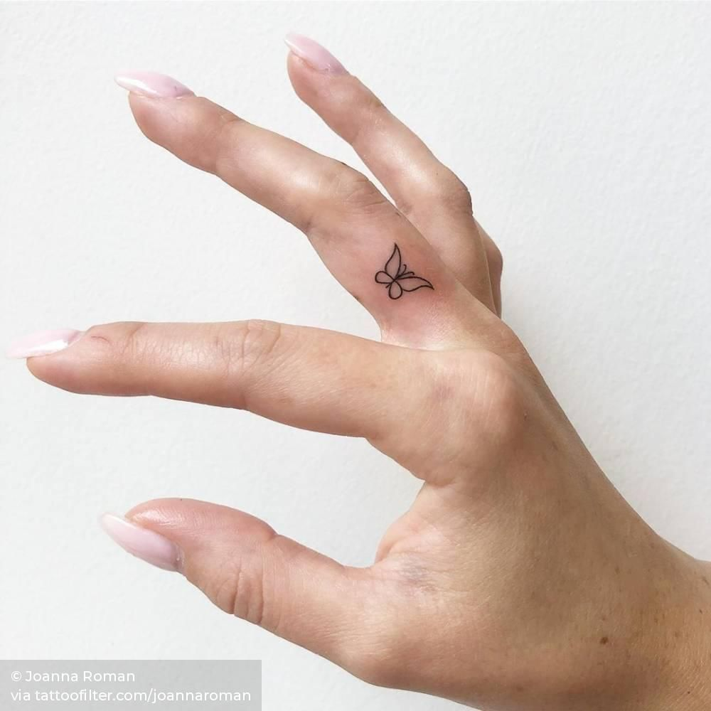 Photo of Tiny butterfly tattoo on the finger.