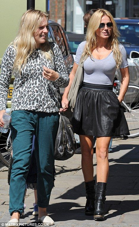 Fashion faux pas: Geri Halliwell looked stylish from the front, before turning around and exposing her bra during a shopping trip in Hampste...