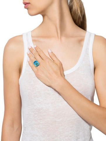 18K yellow gold David Yurman cable ring with faceted blue topaz set between two rows of diamonds. Ring size 6.5.