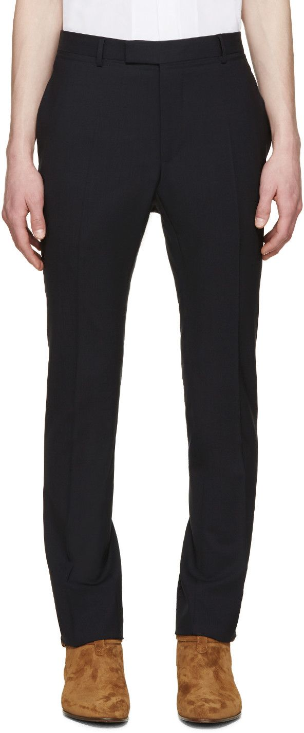 Skinny-fit trousers in deep navy. Three-pocket styling. Unfinished hems at ankle cuffs. Zip-fly. Tonal stitching. #Lanvin