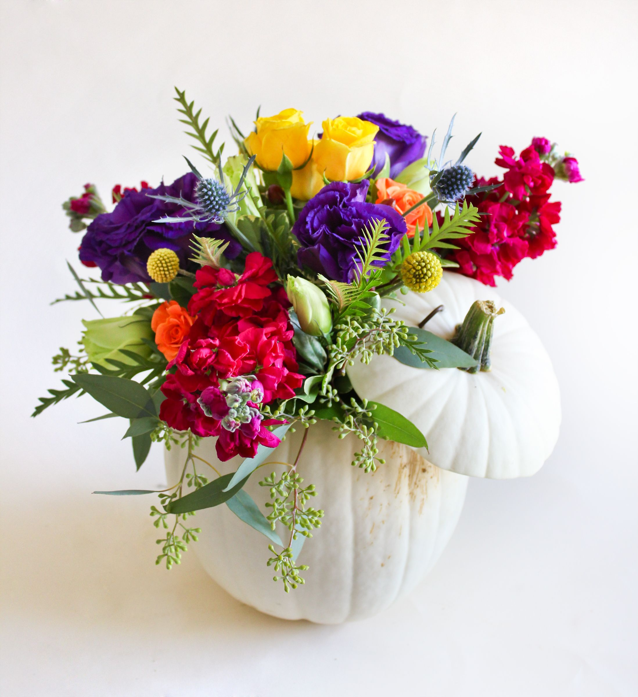 Bright Colored Flowers In A White Pumpkin Take A Different Route