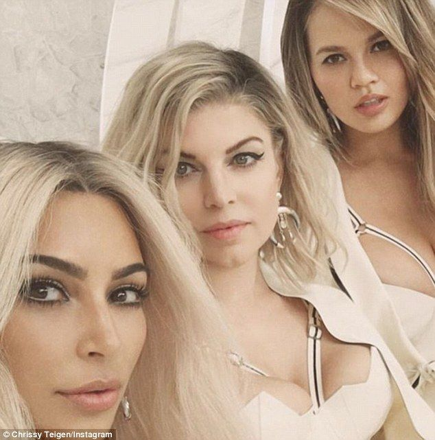 Simply stunning: Teigen Instagrammed a snap of herself with Fergie and Kim from the set of the video