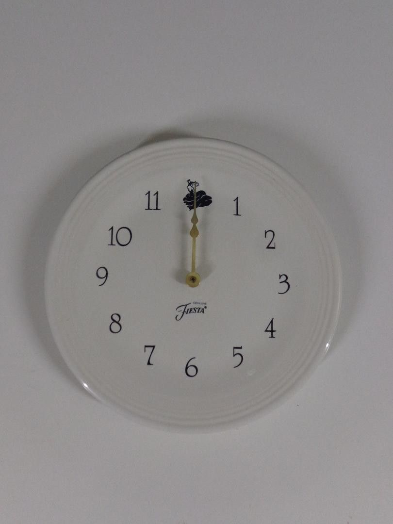 This wall clock plate was made by