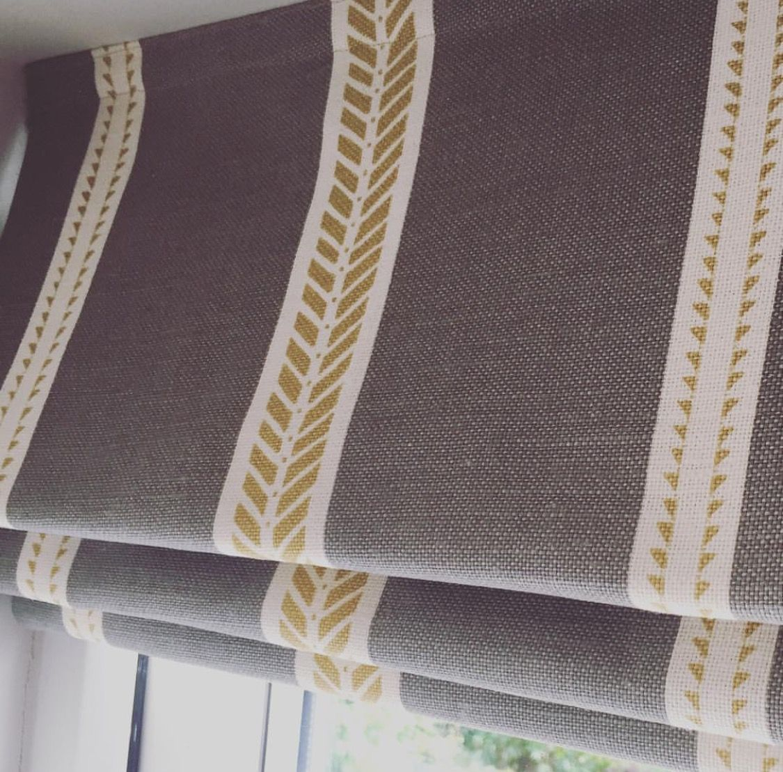 Roman blinds in slade stripe grey fabric by zoe glencross