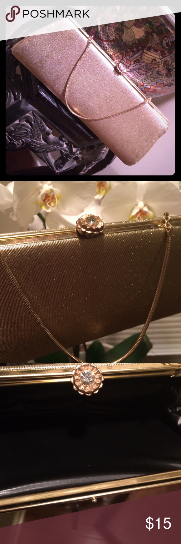 Gold Vintage Clutch with Crystal Clasp Gorgeous old Hollywood/Gatsby style vintage clutch.  Gold metallic fabric exterior accented with crystal encrusted clasp. Gold-tone metal chain offers flexibility to carry by the strap or as a clutch.  Interior features a wipe-clean black fabric. This vintage bag is in great shape. No cracks, tears, or stains on interior or exterior fabric. There are a few indentations on the exterior and minor scratches on the metal frame,but they are not visible in…