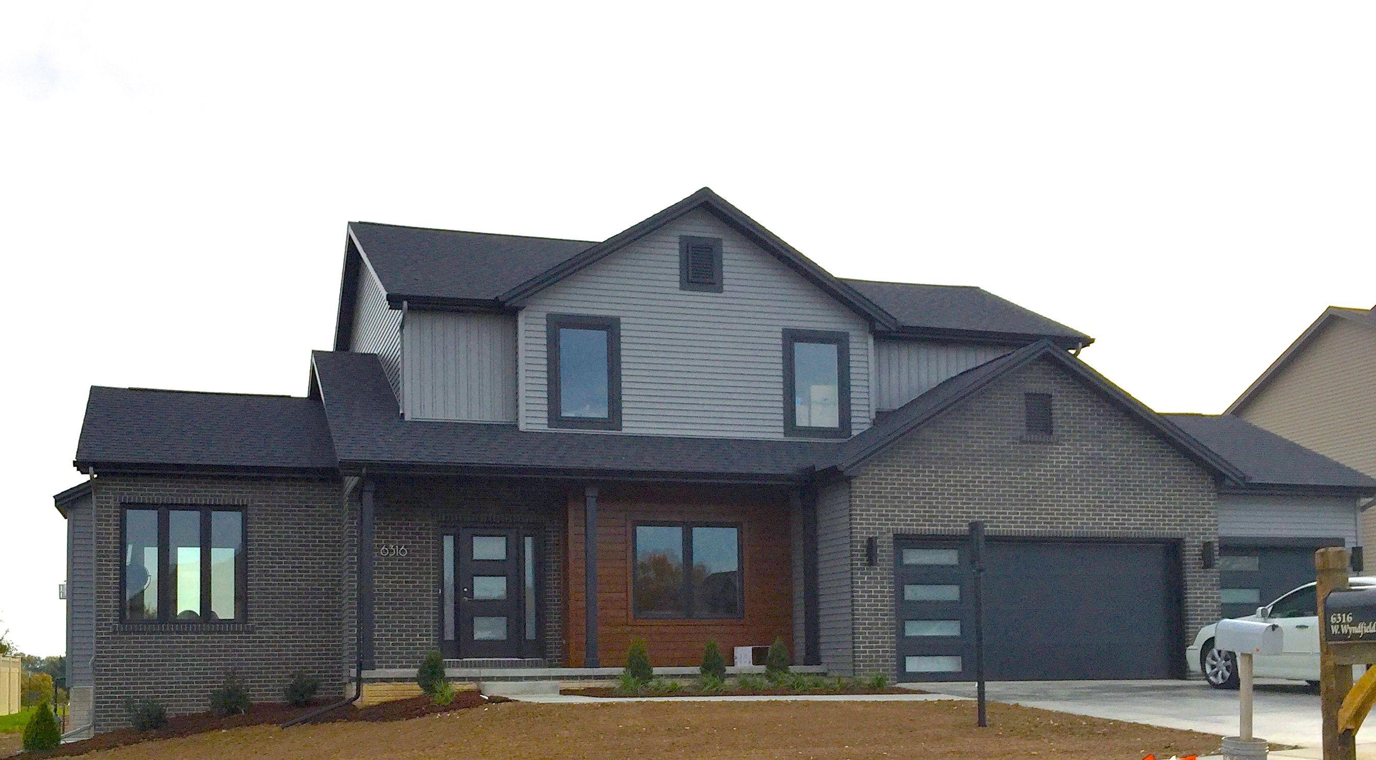 Gray Brick House With Black Trim Mastic Deep Granite Grey Siding