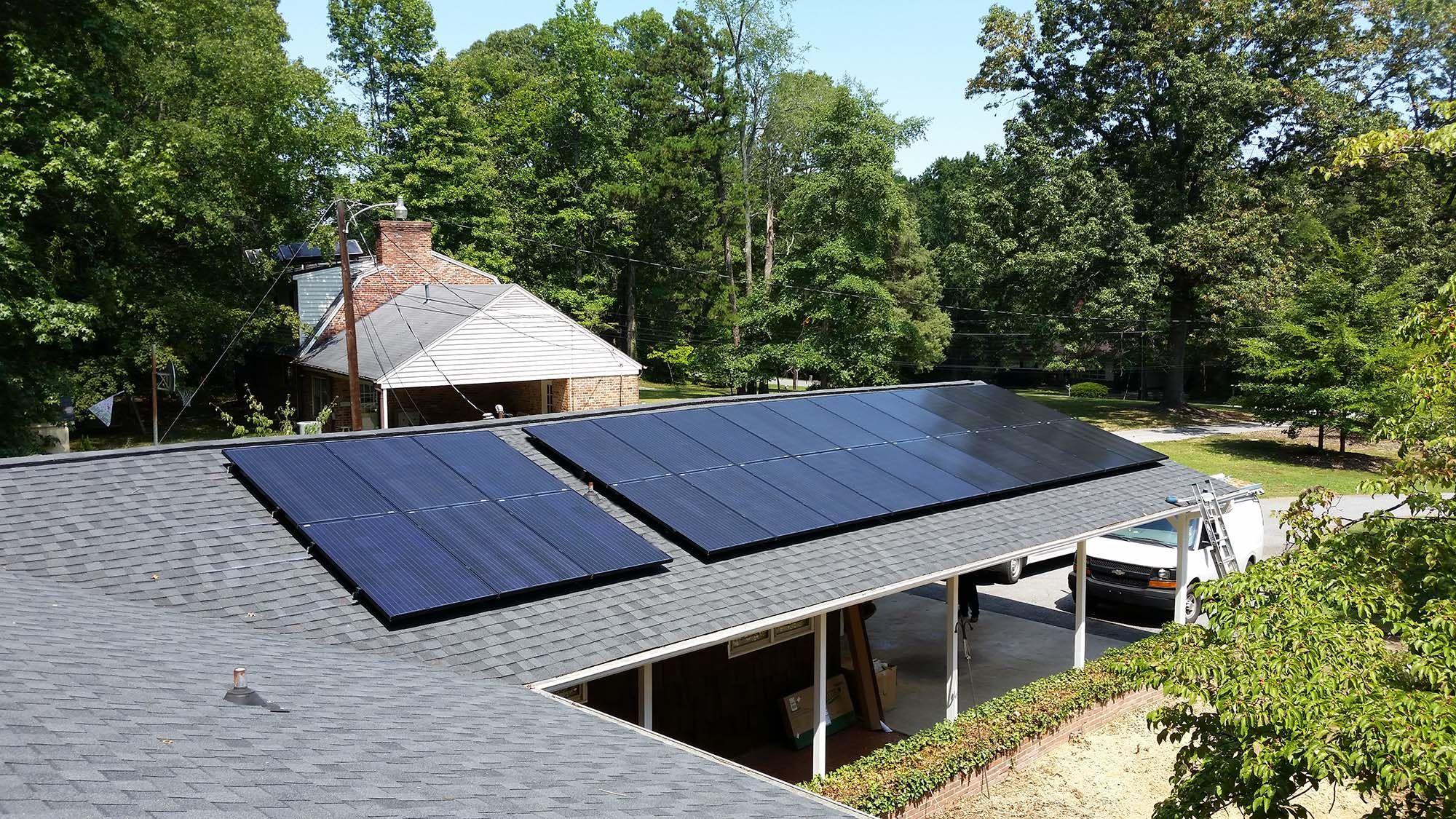 We Installed 26 275 Watt Black On Black Suniva Solar Panels On This Carport In Highpoint Nc Making A 7 15 Solar Array Solar Panels Roof Solar Panel Solar