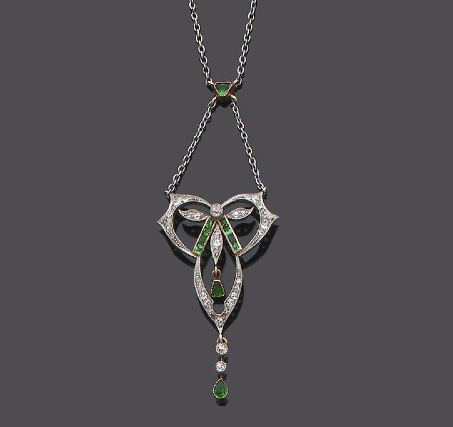 An emerald and diamond pendant the openwork trefoil plaque set to