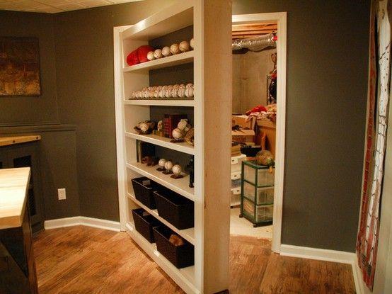 walk in closet with hidden door This hidden bookcase door opens