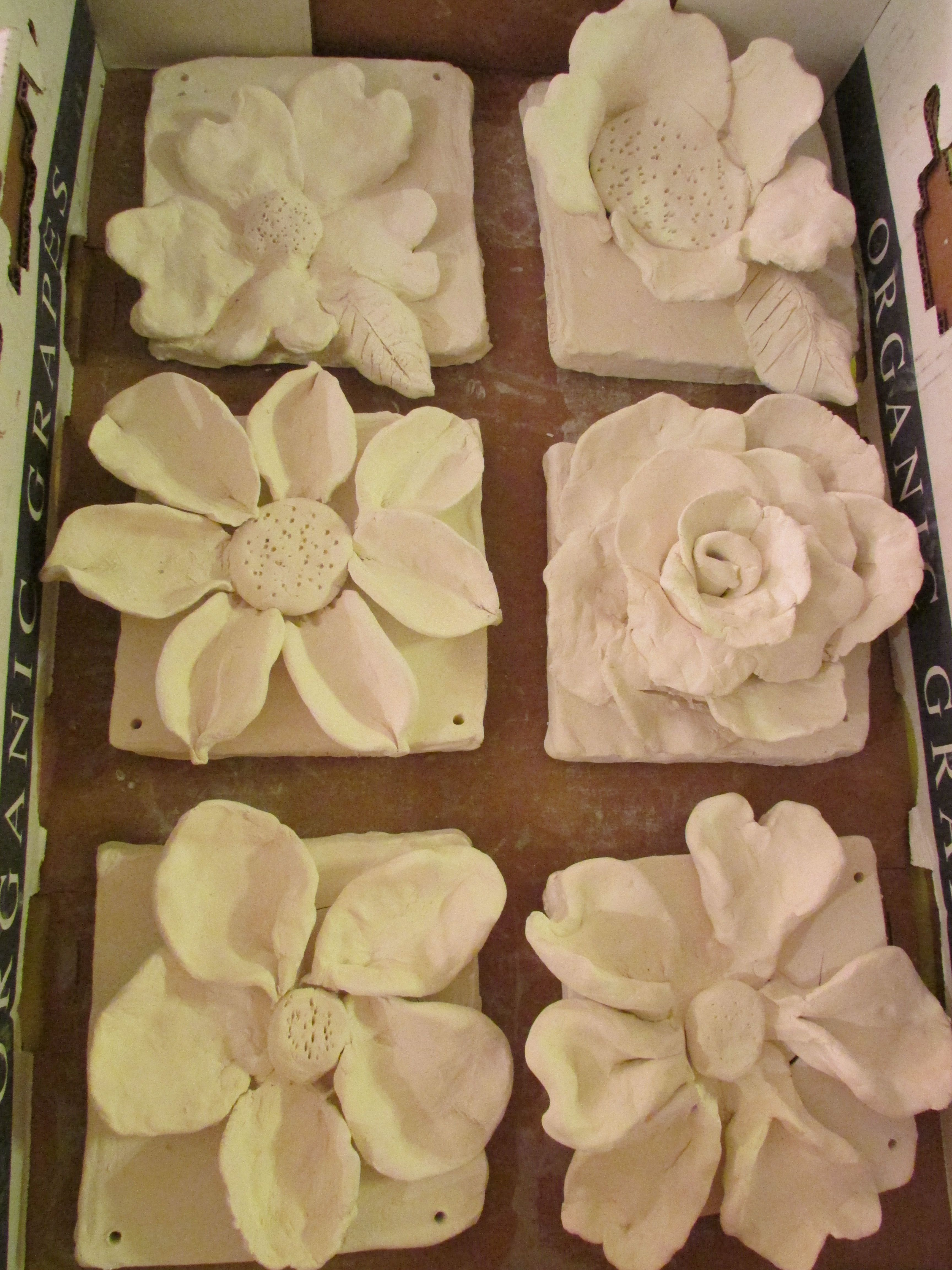 ceramic flower sculptures; approx. 7\
