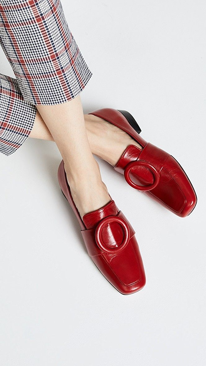 A pair of funky red flats and plaid pants.