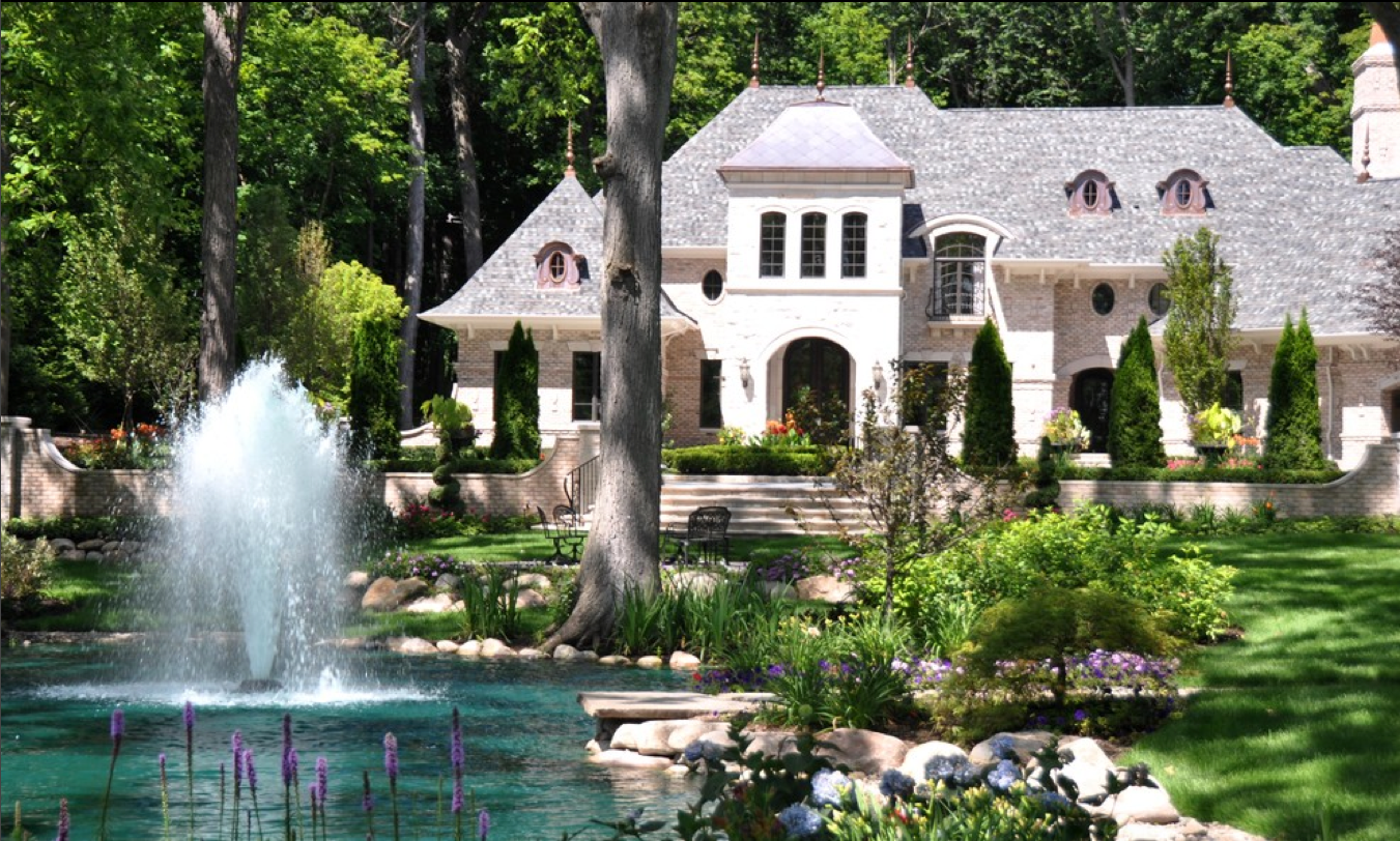 Residential front yard water feature fountain in pond Home water features
