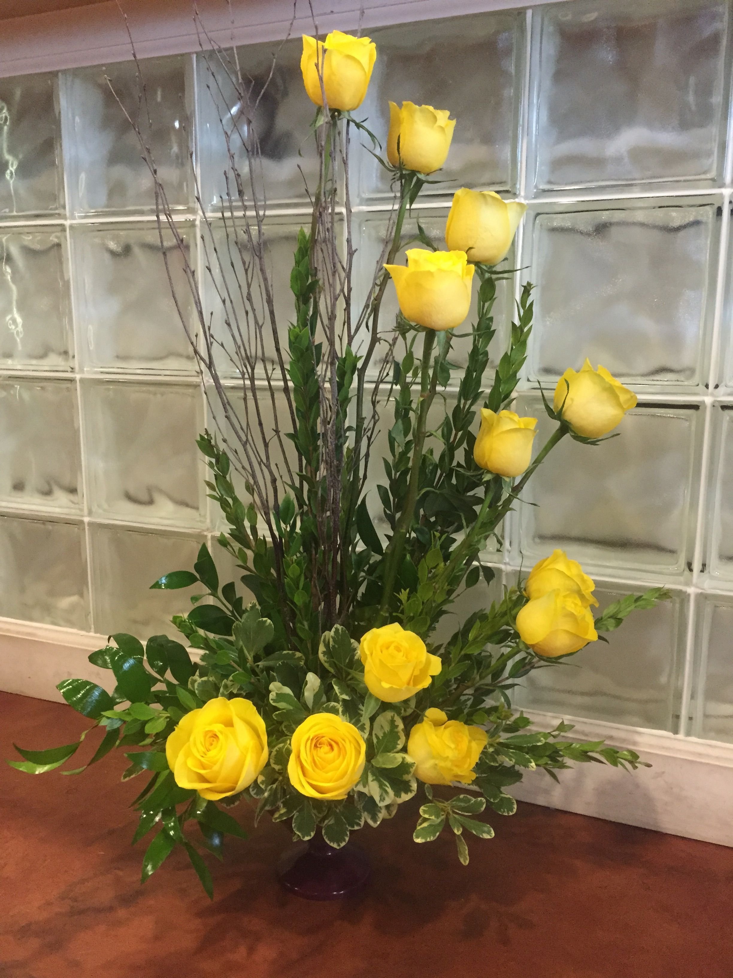 Spiral Style Long Stem Roses Arranged With Fancy Foliage And Birch