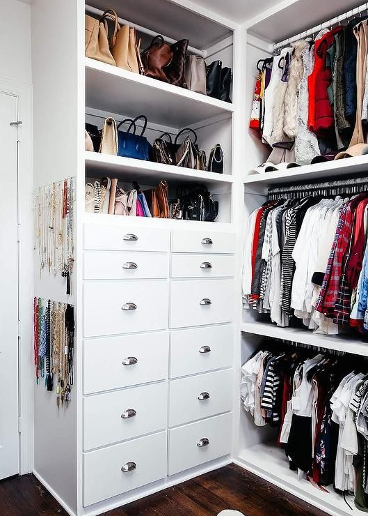 White Walk In Closet Is Fitted With The Container Store 11 Peg Acrylic  Necklace Wall Racks Mounted To The Side Of White Stacked Bag Shelves Fixed  Above A ...
