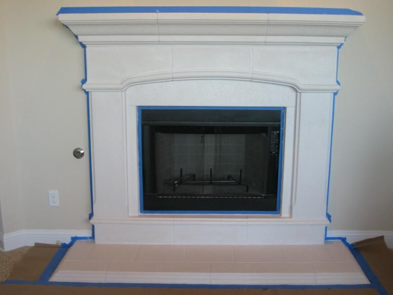 The brown had to go. Painting a cast stone fireplace surround with ...