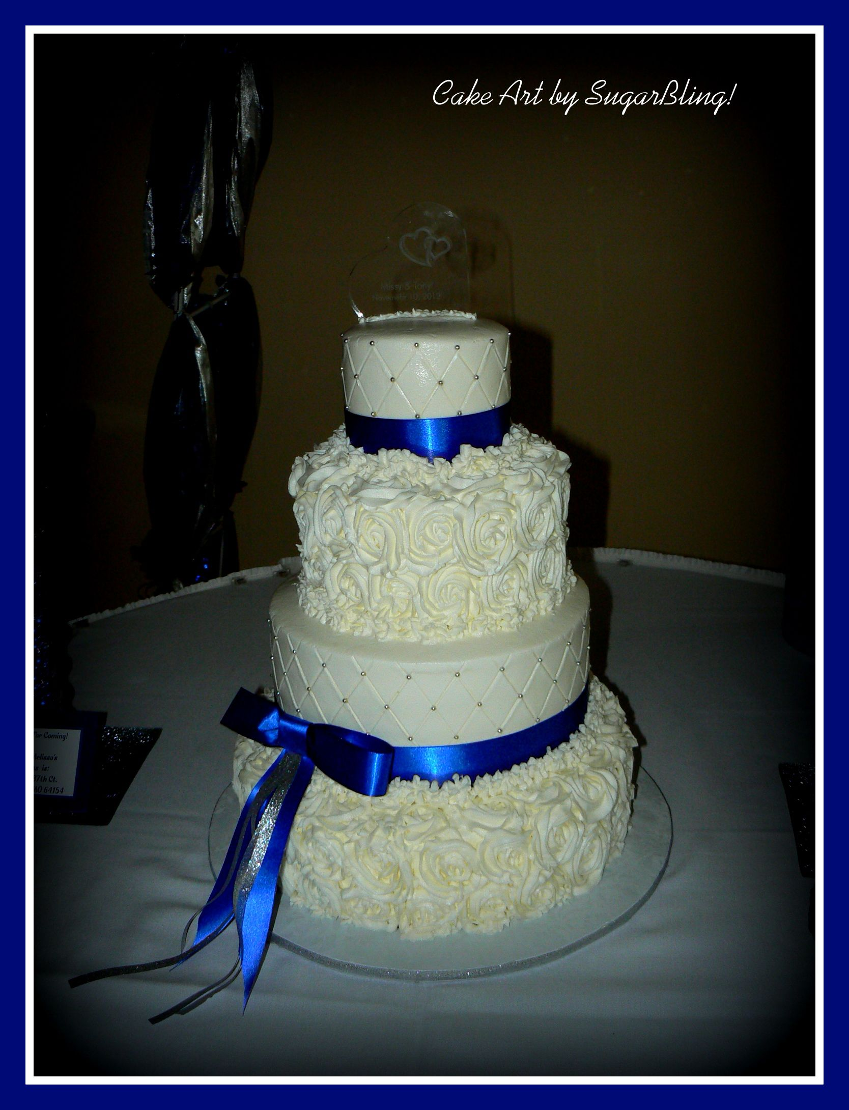 Royal Blue and Rosettes This is a 5 8 11 and 14 cake All