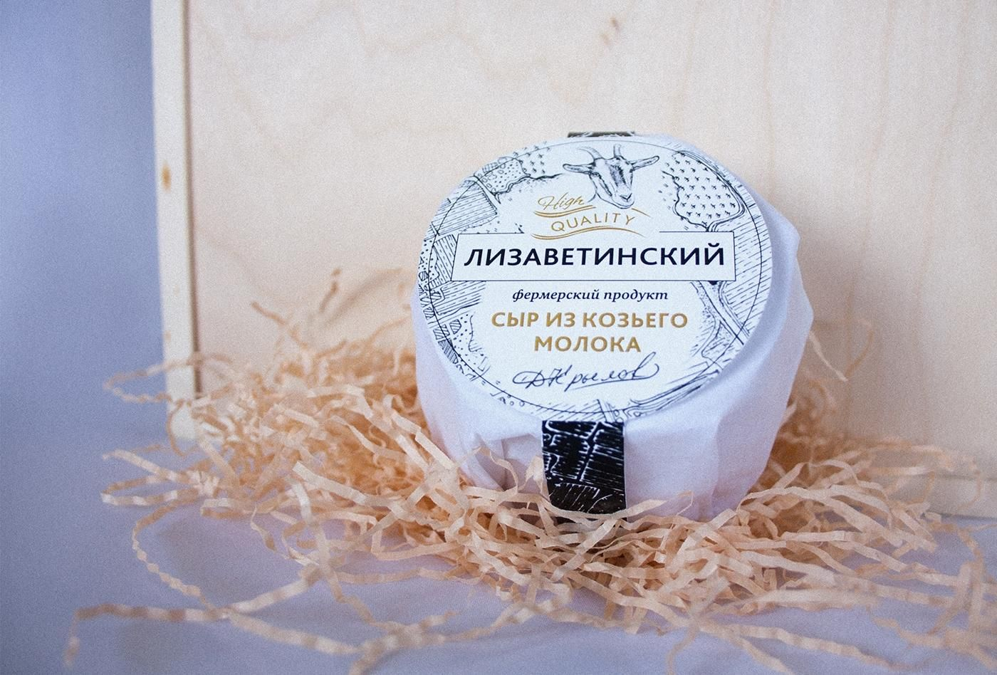 """A cheese """"Lizavetinskiy"""" is a unique farm product, which are manufactured in accordance with an age-old recipes. Grazing goats and milk production is carried out in accordance with the rules of organic farming without using any chemical fertilizers. The packaging should reflect the benefits of the product, positioning it in a given niche. A head of cheese is wrapped in a thin paper, which contains information about the main stages of cheese production. To reflect the local production a real…"""
