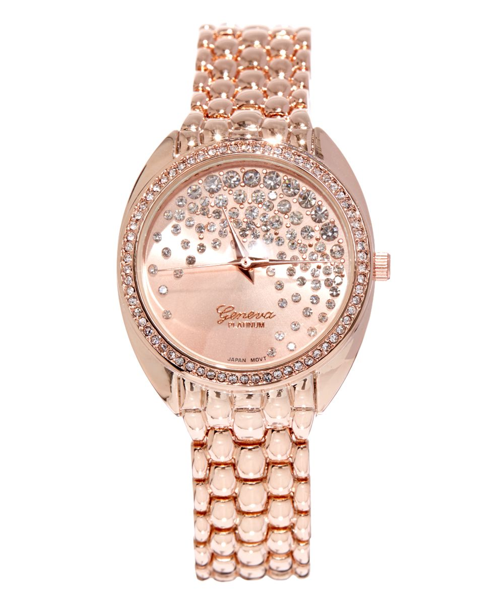 Geneva Rose Gold Rhinestone-Dial Bracelet Watch | zulily  . $16.99 $60.00    Description:  This timepiece completes your ensemble with chic sparkle thanks to a sprinkling of rhinestones on the dial and along the bezel. The rose gold hue lends a classic finish.      Case: 1.3'' diameter     Bracelet: 0.6'' W x 8'' L     Fold-over clasp     Case: metal / alloy     Dial and bezel accent: rhinestone .Japanese quartz movement Analog display Imported