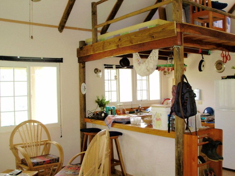 A loft for storage above a small kitchen (With images ...
