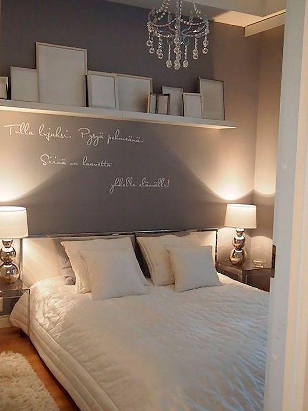 Las paredes grises y las sábanas blancas es una bonita combinación ...