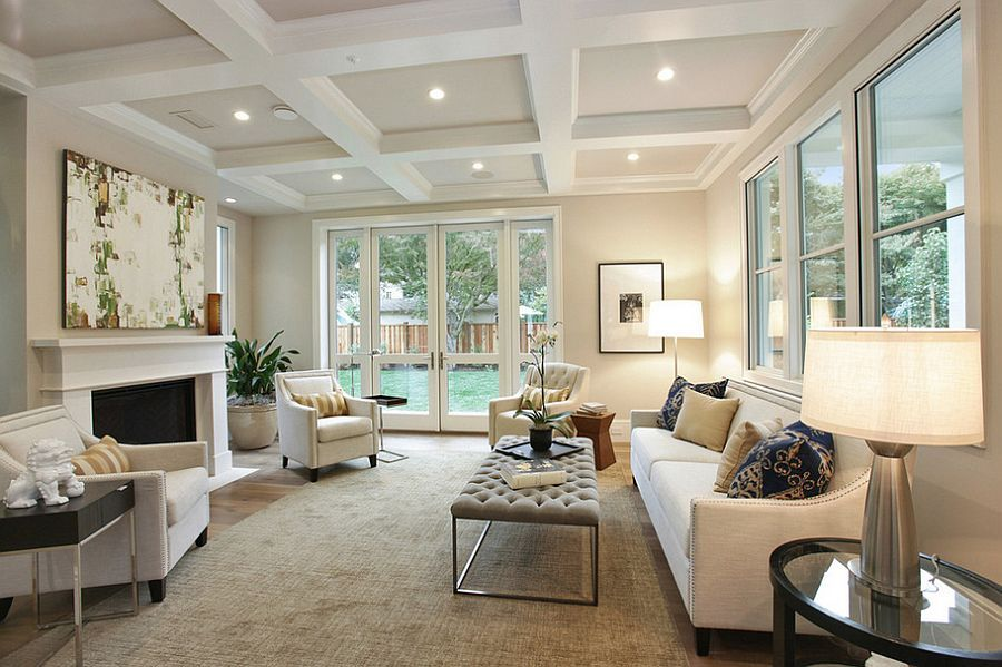 Monochromatic Living Room With A Tufted Coffee Table Design Clarum Homes