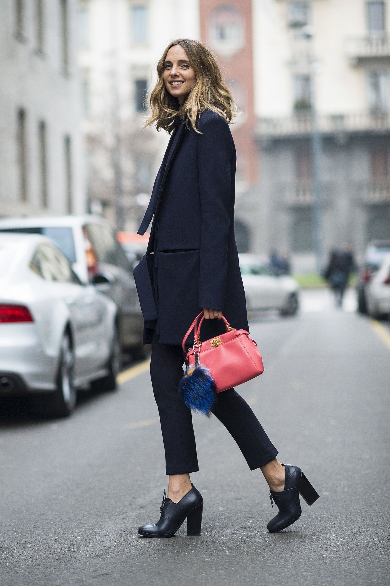 A bright bag and furry Fendi charm gave this menswear-inspired look a  girl's touch