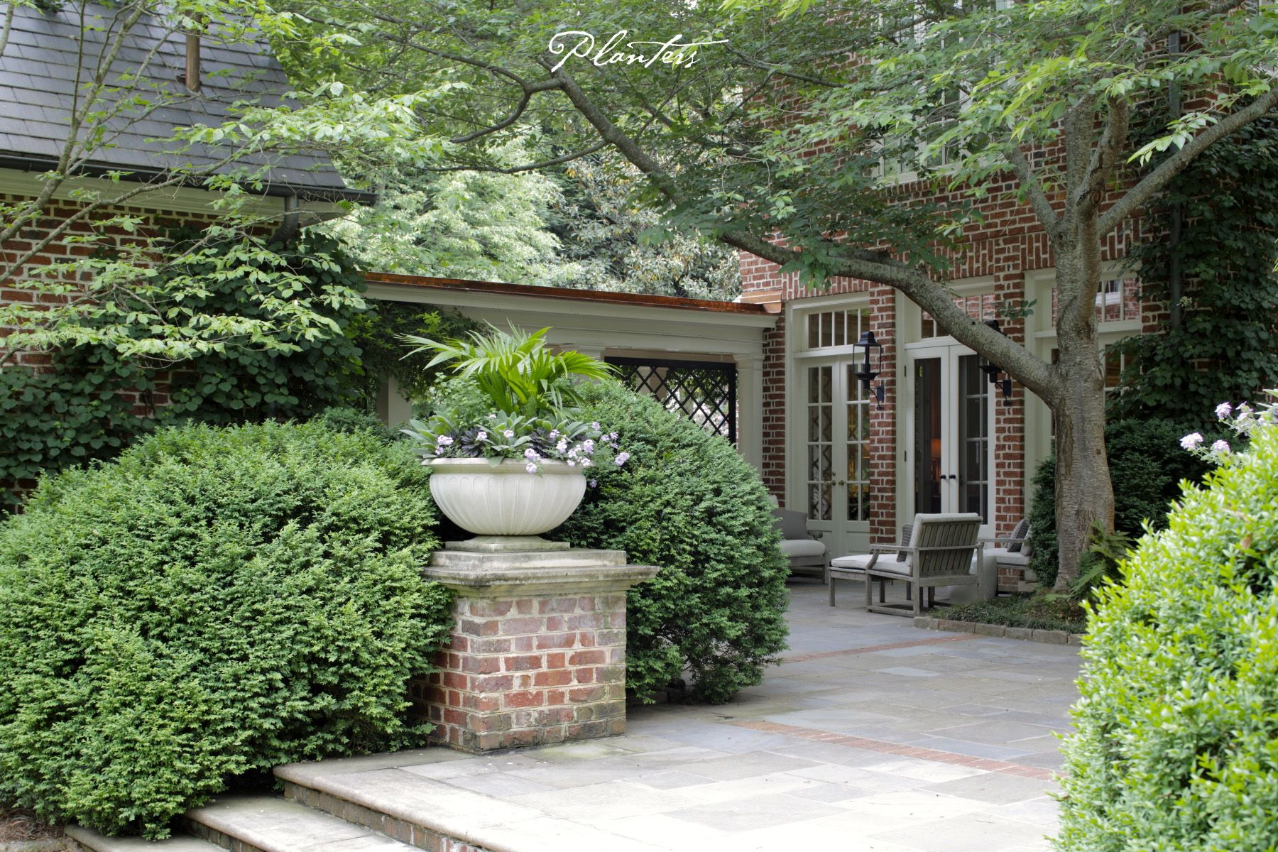 Landscape architect atlanta ga - Bluestone Patio With American Boxwoods And Limestone Garden Bowls Planted With A Chinese Fan Palms And Annual Color A Planters Design