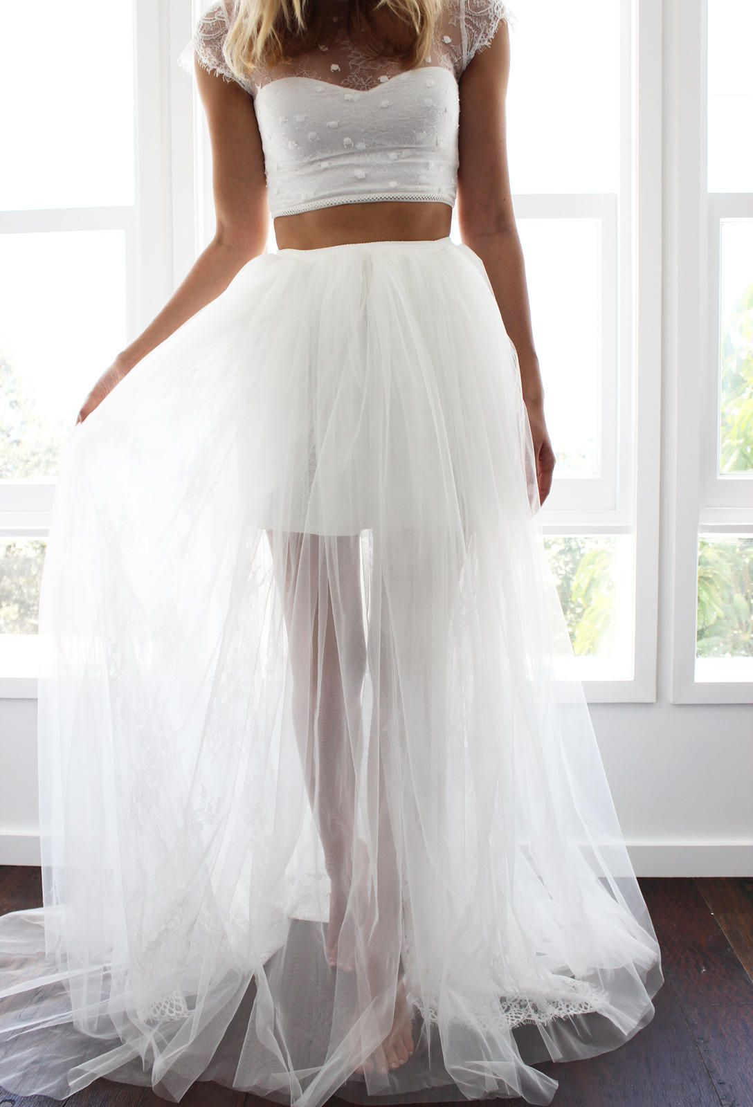 A gorgeous ivory two piece wedding dress made from Italian