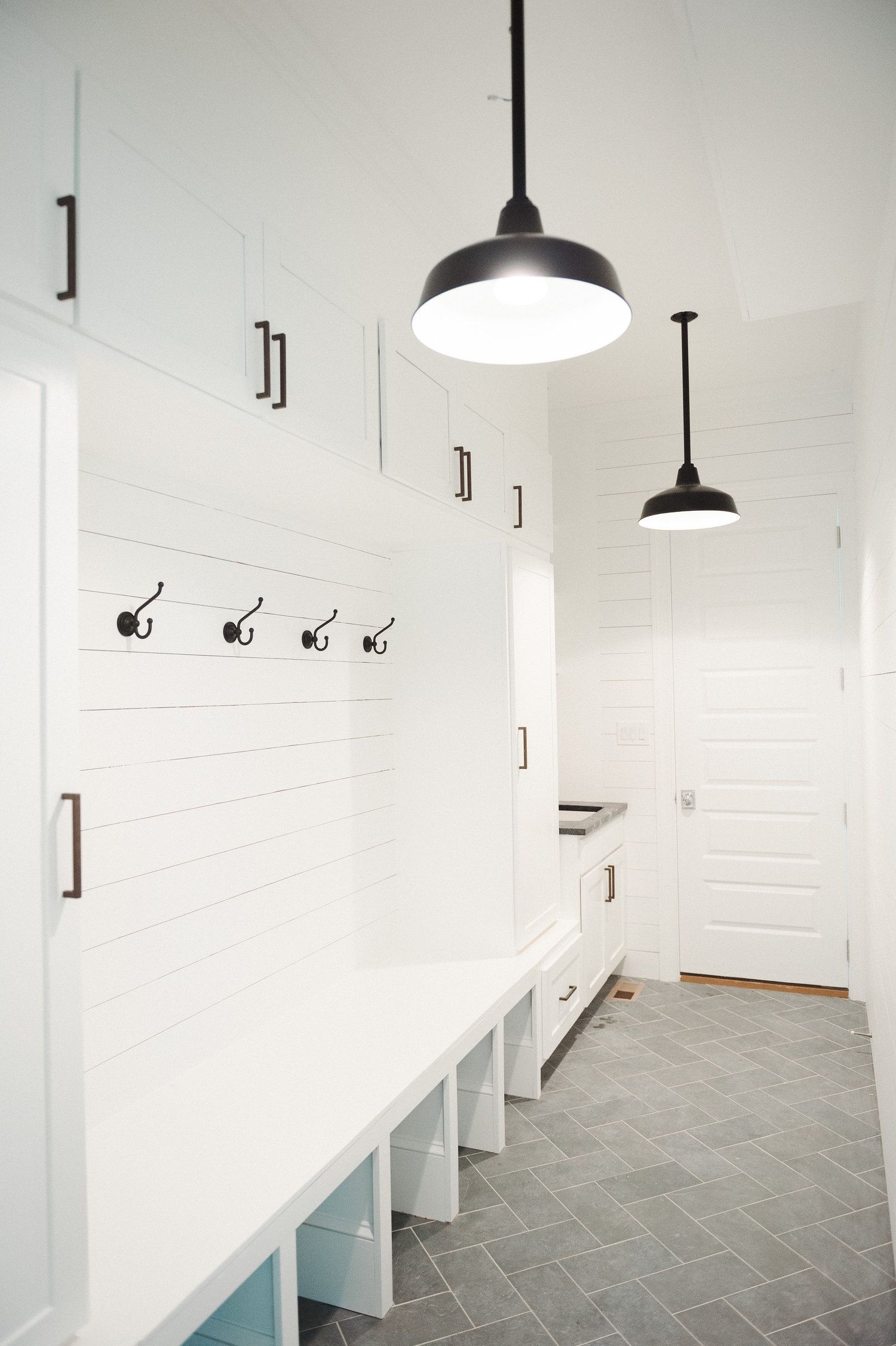Gorgeous laundry room features walls clad in