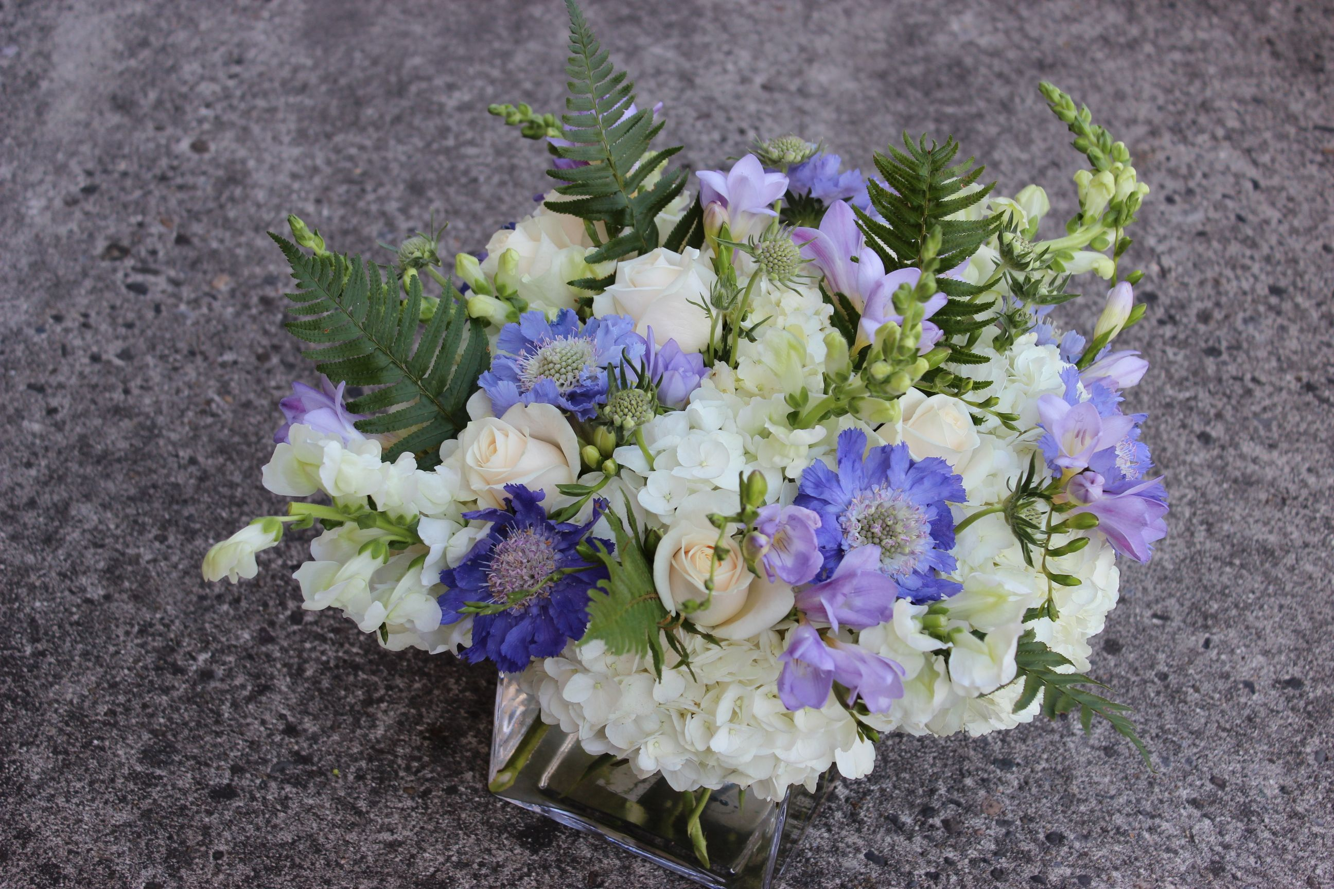 lavenders centerpiece wedding flowers   lavenders   sophisticated floral designs & accessories   http://sophisticatedfloral.com/users/awp.php?ln=110659