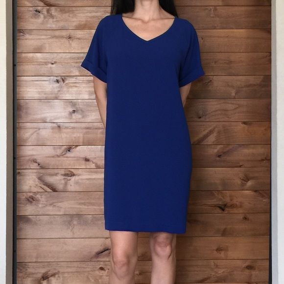 """Chico's Shirtdress V-Neck CHICO'S 'Veronica' v-neck shift dress in Loyal Blue. Relaxed fit. Rolled cuffs sewn in place. Style tip: add a belt for a modern look.  Chico's Size 1, regular size 8 Medium. 100% polyester. 35"""" shoulder to hem. 20"""" armpit to armpit. Chico's Dresses Mini"""