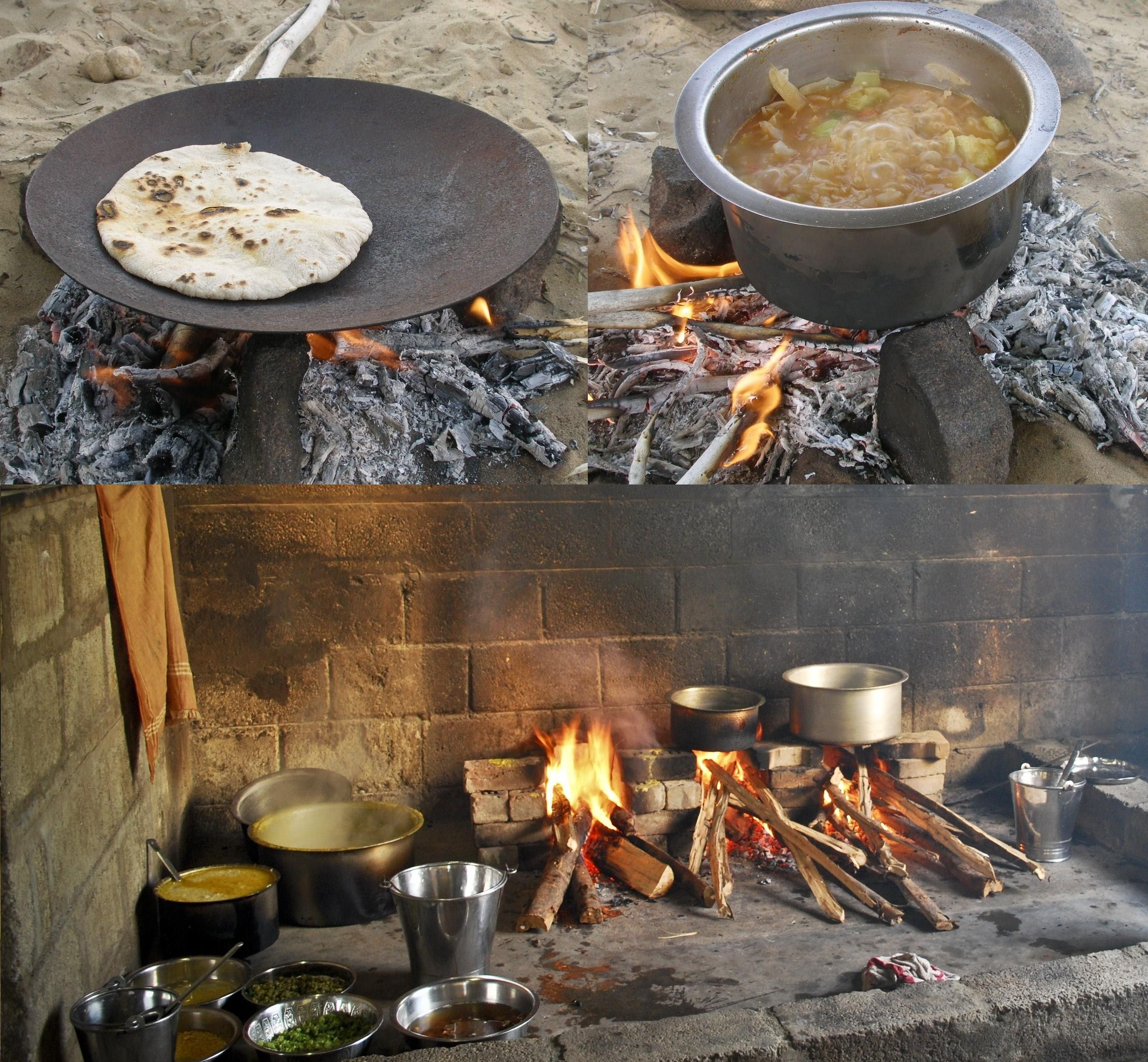 Traditional outdoor Indian cooking in the Thar Desert in Jaisalmer, showing  roti bread and vegetable