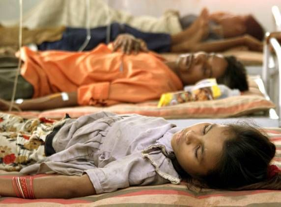 Children Suffering From Malaria Lie On Hospital Beds In Alindra
