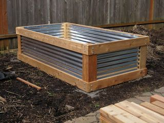 bed made of cedar and corrugated metal roofing.