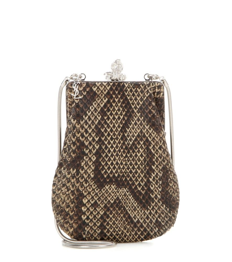 Saint Laurent - Serpent Small snakeskin shoulder bag - Saint Laurent's exotic snakeskin pouch shoulder bag is a glamorous accessory that will instantly bring vintage allure to your evening edit. With a shiny silver-tone serpent and monogram charm, this downsized, beige and deep brown style can be carried in the hand or over the shoulder with the tonal chain shoulder strap. We love it next to an all-black ensemble. seen @ www.mytheresa.com
