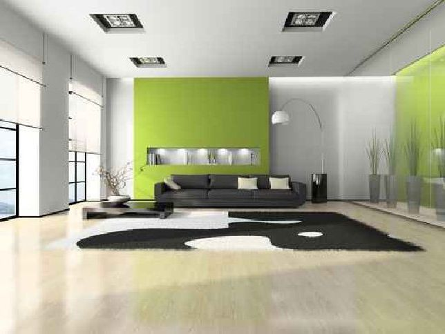 relaxing living room interior design with white green wall paint color and black leather sofa idea