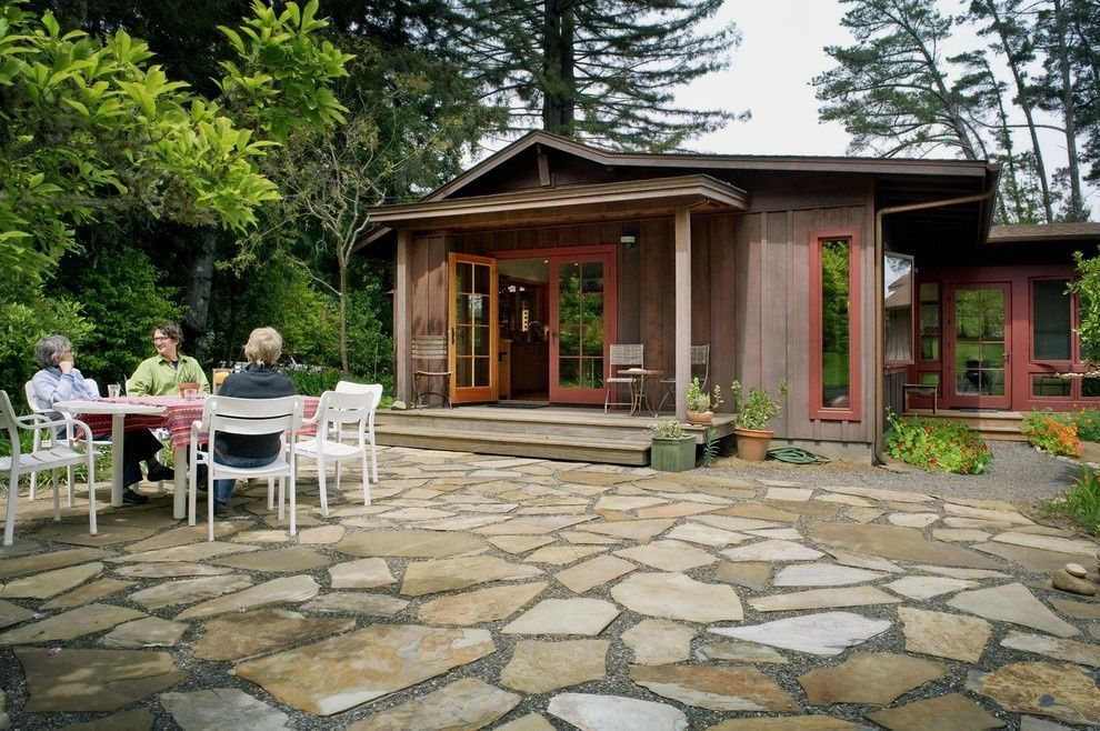 A patio with pebbles and large stones. Creates a permeable ... on Patio Surfaces Ideas id=11362