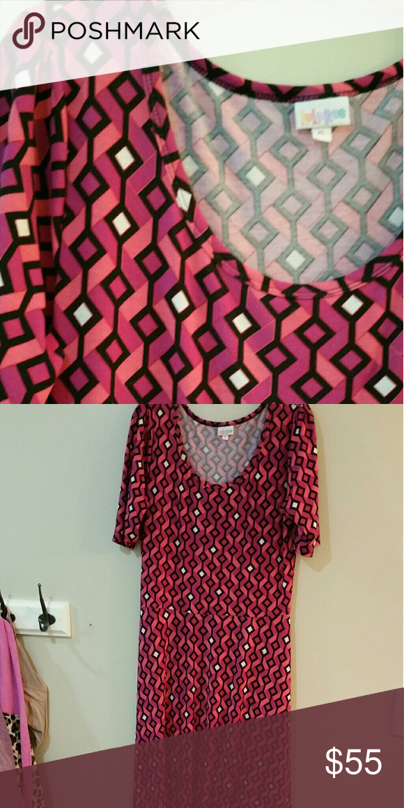 Lularoe Ana pink diamond maxi dress Lularoe Ana in pink anx cream diamonds outlined in black. This is a half sleeve maxi dress.  This is a reposh for me because the style isnt right for me.  It is in excellent used condition, worn twice and washed according to Lularoe instructions. LuLaRoe Dresses Maxi