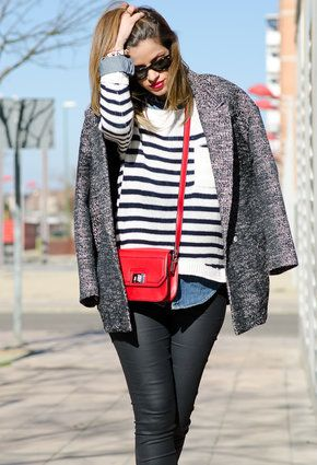 Denim shirt, striped sweater and red bag