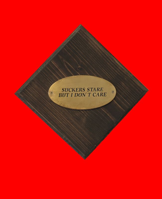 """Swyndle & Hawks, """"Quotes (Word is born Series),"""" 2010, brass on wooden panel"""