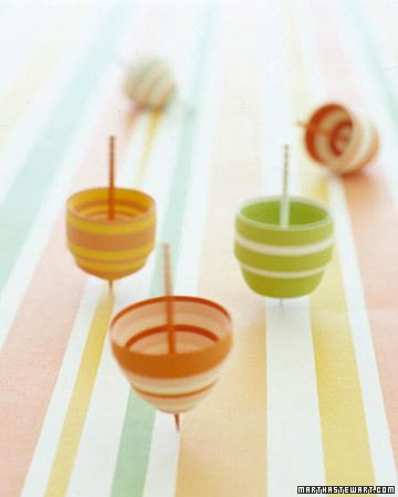 Paper Tops by marthastewart: In minutes, kids can make twirlable tiny tops out of paper strips wound around a toothpick. #DIY #Kids #Tops