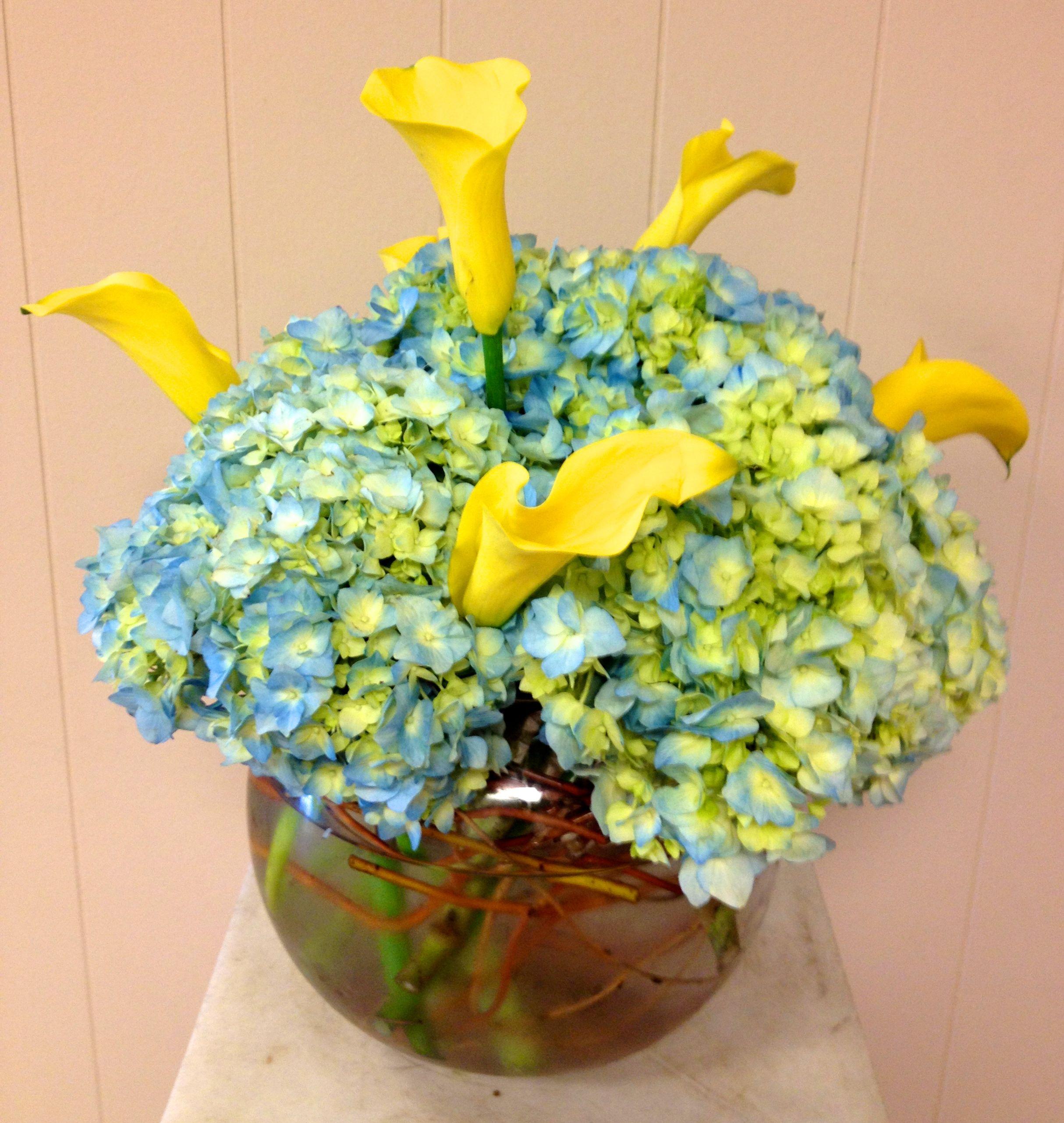 Fun Springy Wedding Centerpiece With Blue Hydrangea And Yellow Calla